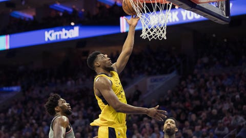 Dec 14, 2018; Philadelphia, PA, USA; Indiana Pacers forward Thaddeus Young (21) scores against Philadelphia 76ers center Joel Embiid (21) and forward Wilson Chandler (22) during the second quarter at Wells Fargo Center. Mandatory Credit: Bill Streicher-USA TODAY Sports