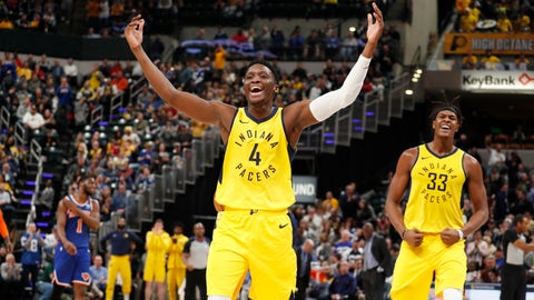 Dec 16, 2018; Indianapolis, IN, USA; Indiana Pacers guard Victor Oladipo (4) and center Myles Turner (33) react to a play against New York Knicks during the fourth quarter at Bankers Life Fieldhouse. Mandatory Credit: Brian Spurlock-USA TODAY Sports