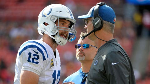 FILE - In this Sept. 16, 2018, file photo, Indianapolis Colts quarterback Andrew Luck, left, speaks with coach Frank Reich, right, during the second half of the team's NFL football game against the Washington Redskins in Landover, Md. The Tennessee Titans hope to have quarterback Marcus Mariota when they try to beat Andrew Luck for the first time with the Colts with an AFC wild-card berth _ at worst _ on the line for the winner of the NFL's final game of the regular season Sunday, Dec. 30, 2018. (AP Photo/Mark Tenally, File)