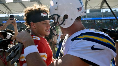In this Sunday, Sept. 9, 2018, file photo, Kansas City Chiefs quarterback Patrick Mahomes, left, greets Los Angeles Chargers quarterback Philip Rivers after a win in an NFL football game in Carson, Calif. The Kansas City Chiefs are missing their star running back, likely without his backup and could have their top two wide receivers hobbled or shelved for their crucial AFC West showdown against the Los Angeles Chargers on Thursday, Dec. 13. (AP Photo/Kelvin Kuo, File)