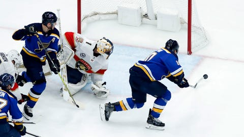 St. Louis Blues' Brayden Schenn, right, scores past Florida Panthers goaltender Roberto Luongo as Blues' Alexander Steen, left, watches during the third period of an NHL hockey game, Tuesday, Dec. 11, 2018, in St. Louis. The Blues won 4-3. (AP Photo/Jeff Roberson)