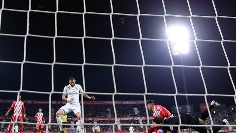 <p>               Real Madrid's Benzema, center left, in action during a Spanish Copa del Rey soccer match between Girona and Real Madrid at the Montilivi stadium in Girona, Spain, Thursday, Jan. 31, 2019. (AP Photo/Manu Fernandez)             </p>