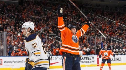 <p>               Buffalo Sabres' Nathan Beaulieu (82) skates past as Edmonton Oilers' Milan Lucic (27) celebrates a goal during second period NHL hockey action in Edmonton, Alberta, on Monday, Jan. 14, 2019. (Jason Franson/The Canadian Press via AP)             </p>