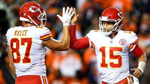 DENVER, CO - OCTOBER 1:  Quarterback Patrick Mahomes #15 of the Kansas City Chiefs celebrates with tight end Travis Kelce #87 after scoring a second quarter rushing touchdown against the Denver Broncos at Broncos Stadium at Mile High on October 1, 2018 in Denver, Colorado. (Photo by Dustin Bradford/Getty Images)