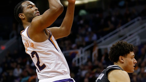 <p>               Phoenix Suns forward T.J. Warren (12) shoots over Sacramento Kings forward Justin Jackson in the second half during an NBA basketball game, Tuesday, Jan. 8, 2019, in Phoenix. Phoenix defeated Sacramento 115-111. (AP Photo/Rick Scuteri)             </p>