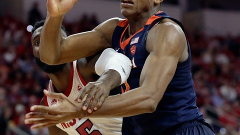 <p>               Virginia's De'Andre Hunter and North Carolina State's Eric Lockett (5) reach for the ball during the second half of an NCAA college basketball game in Raleigh, N.C., Tuesday, Jan. 29, 2019. Virginia won 66-65 in overtime. (AP Photo/Gerry Broome)             </p>
