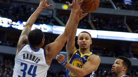<p>               Golden State Warriors guard Stephen Curry (30) passes the ball around Dallas Mavericks guard Devin Harris (34) in the first half of an NBA basketball game Sunday, Jan. 13, 2019, in Dallas. (AP Photo/Richard W. Rodriguez)             </p>