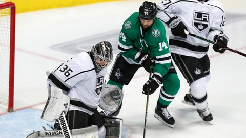 <p>               Dallas Stars left wing Jamie Benn (14) tries to score a goal against Los Angeles Kings goaltender Jack Campbell (36) and defenseman Alec Martinez (27) during the third period of an NHL hockey game in Dallas, Thursday, Jan. 17, 2019. The Kings won 2-1 (AP Photo/LM Otero)             </p>