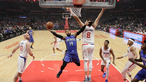 <p>               Orlando Magic's D.J. Augustin (14) drives to the basket as Los Angeles Clippers' Danilo Gallinari (8) defends during the first half of an NBA basketball game Sunday, Jan. 6, 2019, in Los Angeles. (AP Photo/Marcio Jose Sanchez)             </p>