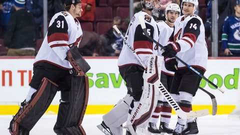 <p>               Arizona Coyotes' Richard Panik (14), of Slovakia, and goalie Darcy Kuemper (35) celebrate Panik's overtime goal against the Vancouver Canucks as goalie Adin Hill (31) skates to join them, after an NHL hockey game Thursday, Jan. 10, 2019, in Vancouver, British Columbia. (Darryl Dyck/The Canadian Press via AP)             </p>