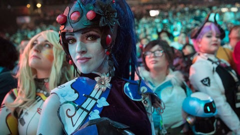 <p>               FILE - In this July 28, 2018 file photo, cosplayer fans watch the competition between Philadelphia Fusion and London Spitfire during the Overwatch League Grand Finals competition, at Barclays Center in the Brooklyn borough of New York.  Most professional esports are devoid of female players at their highest levels, even though 45 percent of U.S. gamers are women or girls. Executives for titles like League of Legends and Overwatch say they are eager to add women to pro rosters, but many female gamers say they're discouraged from chasing such careers by toxic behavior and other barriers. (AP Photo/Mary Altaffer, File)             </p>