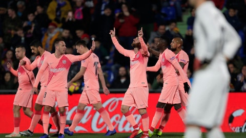 <p>               FC Barcelona's Lionel Messi celebrates after scoring during a Spanish La Liga soccer match between Getafe and FC Barcelona at the Alfonso Perez stadium in Getafe, Spain, Sunday, Jan. 6, 2019. (AP Photo/Manu Fernandez)             </p>