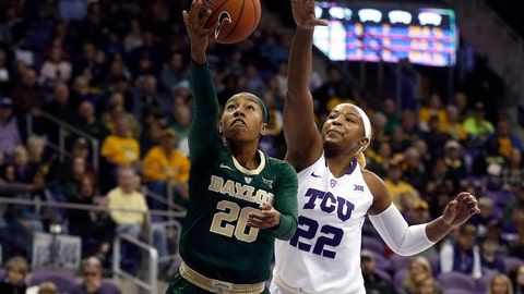 <p>               Baylor guard Juicy Landrum (20) drives inside for a shot as TCU center Jordan Moore (22) defends during the first half of an NCAA college basketball game Saturday, Jan. 12, 2019, in Fort Worth, Texas. (AP Photo/Ron Jenkins)             </p>