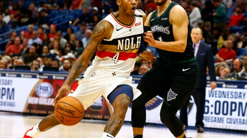 <p>               New Orleans Pelicans guard Elfrid Payton (4) drives to the basket around Minnesota Timberwolves guard Tyus Jones (1) during the second half of an NBA basketball game, Monday, Dec. 31, 2018, in New Orleans. (AP Photo/Butch Dill)             </p>