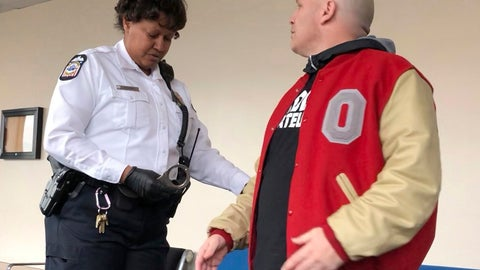 <p>               Mike DiSabato, right, turns himself in for arrest by an officer at Franklin County Municipal Court in Columbus, Ohio, on Monday, Jan. 7, 2019. DiSabato, whose claims helped spur the investigation into alleged, decades-old sexual abuse by an Ohio State team doctor, was jailed in a tangentially related telecommunications harassment case after missing a court date that he says he was misinformed about and never intended to skip. (AP Photo/Kantele Franko)             </p>