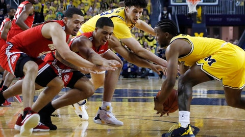 <p>               Michigan guard Zavier Simpson, right, steals the ball away from Ohio State forward Jaedon LeDee, center left, during the first half of an NCAA college basketball game Tuesday, Jan. 29, 2019, in Ann Arbor, Mich. (AP Photo/Carlos Osorio)             </p>