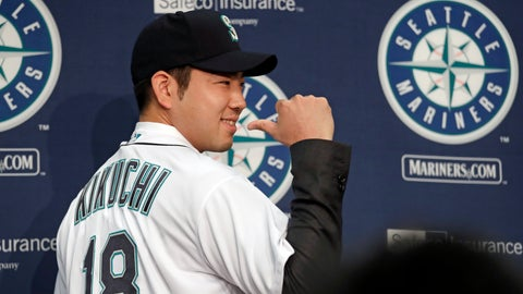 <p>               Seattle Mariners pitcher Yusei Kikuchi smiles and shows off his new jersey following a news conference after his signing with the team, Thursday, Jan. 3, 2019, in Seattle. Kikuchi is the latest Japanese star to decide on calling Seattle home in the majors. The Mariners hope their new left-handed pitcher can help in their rebuild process. (AP Photo/Elaine Thompson)             </p>