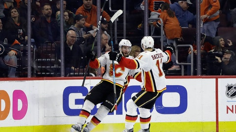 <p>               Calgary Flames' TJ Brodie, left, celebrates with Mikael Backlund after Brodie scored the game-winning goal in overtime of an NHL hockey game against the Philadelphia Flyers, Saturday, Jan. 5, 2019, in Philadelphia. Calgary won 3-2. (AP Photo/Matt Slocum)             </p>