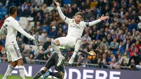 <p>               Real Madrid's Sergio Ramos jumps, with Real Sociedad's Asier Illarramendi, obscured behind, during a Spanish La Liga soccer match between Real Madrid and Real Sociedad at the Santiago Bernabeu stadium in Madrid, Spain, Sunday, Jan. 6, 2019. (AP Photo/Paul White)             </p>