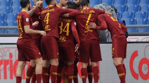 <p>               Roma players celebrate after Nicolo' Zaniolo scored their side's opening goal during a Serie A soccer match between Roma and Torino, at the Rome Olympic Stadium, Saturday, Jan. 19, 2019. (AP Photo/Andrew Medichini)             </p>
