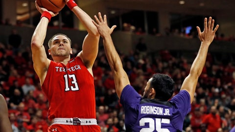 <p>               Texas Tech's Matt Mooney (13) jumps back to shoot the ball over TCU's Alex Robinson (25) during the second half of an NCAA college basketball game Monday, Jan. 28, 2019, in Lubbock, Texas. (AP Photo/Brad Tollefson)             </p>