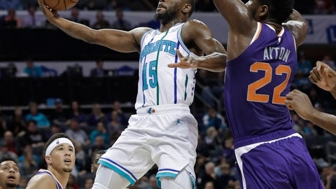 <p>               Charlotte Hornets' Kemba Walker (15) drives past Phoenix Suns' Deandre Ayton (22) during the first half of an NBA basketball game in Charlotte, N.C., Saturday, Jan. 19, 2019. (AP Photo/Chuck Burton)             </p>