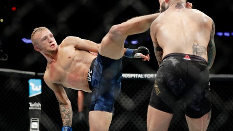 <p>               FILE - In this Nov. 4, 2017, file photo, T.J. Dillashaw, left, kicks Cody Garbrandt during a bantamweight title mixed martial arts bout at UFC 217 in New York. ESPN will raise the curtain on the octagon Saturday, Jan. 19, 2019, and air the first card of a $1.5 billion, five-year deal that will plaster UFC all over the sports network's various platforms. (AP Photo/Frank Franklin II, File)             </p>
