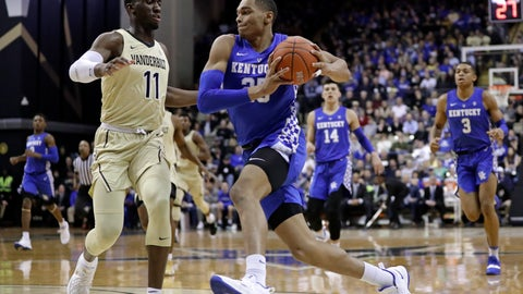 <p>               Kentucky forward PJ Washington (25) drives against Vanderbilt forward Simisola Shittu (11) in the first half of an NCAA college basketball game Tuesday, Jan. 29, 2019, in Nashville, Tenn. (AP Photo/Mark Humphrey)             </p>