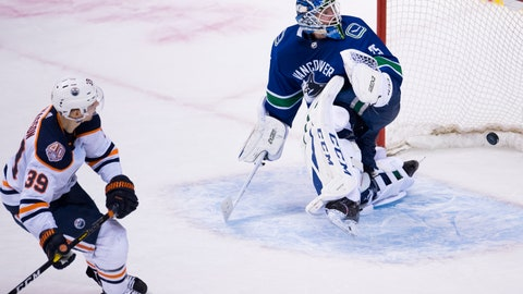 <p>               Edmonton Oilers right wing Alex Chiasson (39) scores past Vancouver Canucks goaltender Jacob Markstrom (25) during the shootout in an NHL hockey game Wednesday, Jan. 16, 2019, in Vancouver, British Columbia. (Jonathan Hayward/The Canadian Press via AP)             </p>