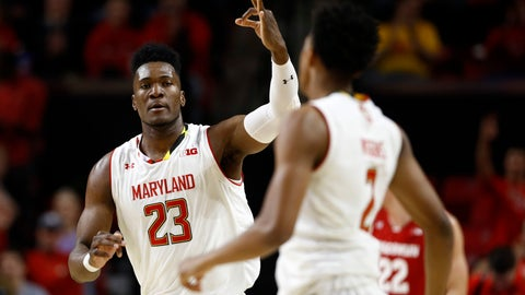 <p>               Maryland forward Bruno Fernando, of Angola, (23) gestures to teammate Aaron Wiggins after Wiggins made a 3-pointer in the first half of an NCAA college basketball game against Wisconsin, Monday, Jan. 14, 2019, in College Park, Md. (AP Photo/Patrick Semansky)             </p>