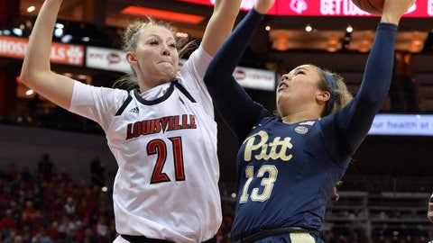 <p>               Pittsburgh guard Kyla Nelson (13) attempts to shoot over the defense of Louisville forward Kylee Shook (21) during the first half of an NCAA college basketball game in Louisville, Ky., Sunday, Jan. 27, 2019. (AP Photo/Timothy D. Easley)             </p>
