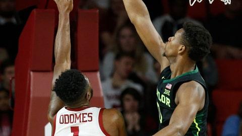 <p>               Baylor forward Flo Thamba, right, blocks a shot by Oklahoma guard Rashard Odomes (1) in the first half of an NCAA college basketball game in Norman, Okla., Monday, Jan. 28, 2019. (AP Photo/Sue Ogrocki)             </p>
