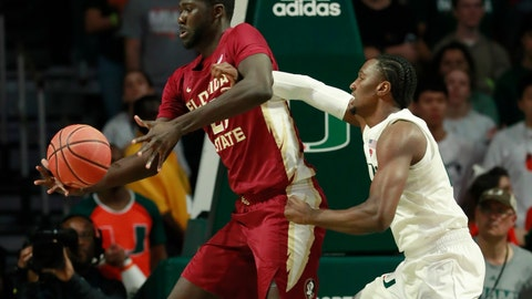 <p>               Florida State center Christ Koumadje, left, and Miami center Ebuka Izundu battle for the ball during the first half of an NCAA college basketball game, Sunday, Jan. 27, 2019, in Coral Gables, Fla. (AP Photo/Wilfredo Lee)             </p>