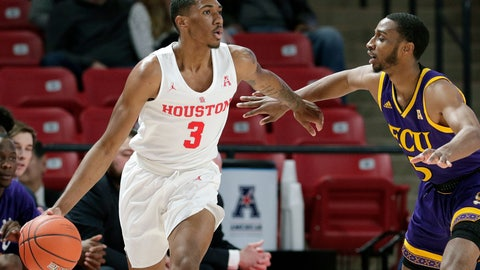 <p>               Houston guard Armoni Brooks (3) looks for a way around East Carolina guard Tyler Foster (5) during the first half of an NCAA college basketball game Wednesday, Jan. 23, 2019, in Houston. (AP Photo/Michael Wyke)             </p>