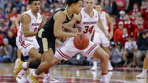 <p>               Purdue's Carsen Edwards (3) drives against Wisconsin's D'Mitrik Trice, left, and Brad Davison (34) during overtime of an NCAA college basketball game Friday, Jan. 11, 2019, in Madison, Wis. Edwards had a game-high 36 points in Purdue's 84-80 win. (AP Photo/Andy Manis)             </p>