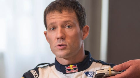 <p>               FILE - In this Thursday, Jan. 25, 2018 file photo, French driver Sebastien Ogier on M-Sport Ford speaks to the media prior to the start of the 86th Monte Carlo Rally, in Monaco. World champion Sebastien Ogier won the season-opening Monte Carlo rally on Sunday Jan. 27, 2019, beating main rival Thierry Neuville by just 2.2 seconds in the race's closest ever finish. (AP Photo/Christian Alminana, File)             </p>