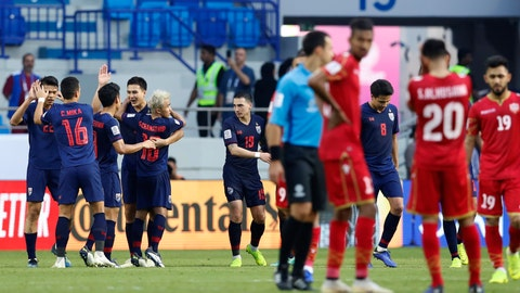<p>               Thailand players, left, celebrate after they beat Bahrain 1-0, during the AFC Asian Cup group A soccer match between Bahrain and Thailand at Al Maktoum Stadium in Dubai, United Arab Emirates, Thursday, Jan. 10, 2019. (AP Photo/Hassan Ammar)             </p>