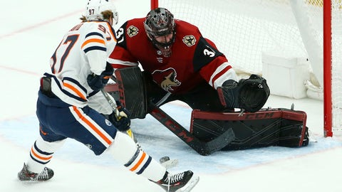 <p>               Edmonton Oilers center Connor McDavid (97) slides the puck between the legs of Arizona Coyotes goaltender Adin Hill (31) for a goal during the second period of an NHL hockey game Wednesday, Jan. 2, 2019, in Glendale, Ariz. (AP Photo/Ross D. Franklin)             </p>