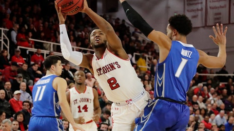 <p>               St. John's Shamorie Ponds (2) shoots over Creighton's Davion Mintz (1) during the second half of an NCAA college basketball game Wednesday, Jan. 16, 2019, in New York. St. John's won 81-66. (AP Photo/Frank Franklin II)             </p>
