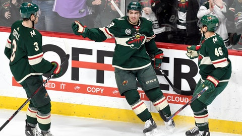 <p>               Minnesota Wild's Charlie Coyle (3) and Jared Spurgeon (46) move in to celebrate the goal of Luke Kunin, center, against the Detroit Red Wings in the first period of an NHL hockey game Saturday, Jan. 12, 2019, in St. Paul, Minn. (AP Photo/Tom Olmscheid)             </p>
