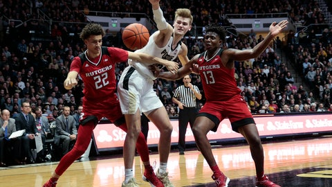 <p>               Purdue center Matt Haarms, center, battles for a rebound with Rutgers Caleb McConnell (22) and Shaq Carter (13) during the second half of an NCAA college basketball game in West Lafayette, Ind., Tuesday, Jan. 15, 2019. Purdue won 89-54. (AP Photo/AJ Mast)             </p>
