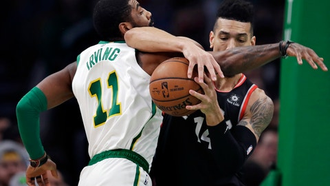<p>               Boston Celtics guard Kyrie Irving (11) and Toronto Raptors guard Danny Green, right, tangle as they compete for the ball during the first quarter of an NBA basketball game in Boston, Wednesday, Jan. 16, 2019. (AP Photo/Charles Krupa)             </p>