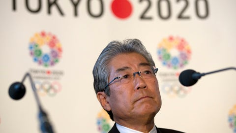 """<p>               FILE - This is a Thursday, Jan. 10, 2013 file photo of Tsunekazu Takeda, President of the Tokyo 2020 Olympic games bid, as he listens to a question from the media during their first international presentation of the Tokyo 2020 Olympic Games bid in London. France's financial crimes office says International Olympic Committee member Takeda is being investigated for corruption related to the 2020 Tokyo Olympics. The National Financial Prosecutors office says Takeda, the president of the Japanese Olympic Committee, was placed under formal investigation for """"active corruption"""" on Dec. 10.(AP Photo/Alastair Grant, File)             </p>"""
