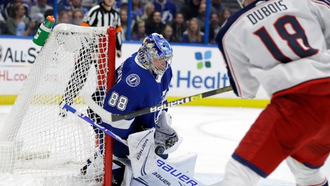 <p>               Tampa Bay Lightning goaltender Andrei Vasilevskiy (88) makes a save on a shot by Columbus Blue Jackets center Pierre-Luc Dubois (18) during the first period of an NHL hockey game Tuesday, Jan. 8, 2019, in Tampa, Fla. (AP Photo/Chris O'Meara)             </p>
