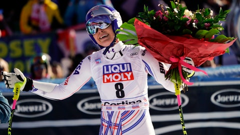 <p>               United States' Lindsey Vonn holds a bunch of flowers she was given after completing an alpine ski, women's World Cup super-G in Cortina D'Ampezzo, Italy, Sunday, Jan. 20, 2019. (AP Photo/Giovanni Auletta)             </p>