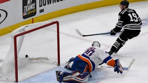<p>               Chicago Blackhawks center Jonathan Toews (19) scores a shootout goal past New York Islanders goaltender Robin Lehner (40) during an NHL hockey game on Tuesday Jan. 22, 2019, in Chicago. The Chicago Blackhawks won 3-2. (AP Photo/Matt Marton)             </p>