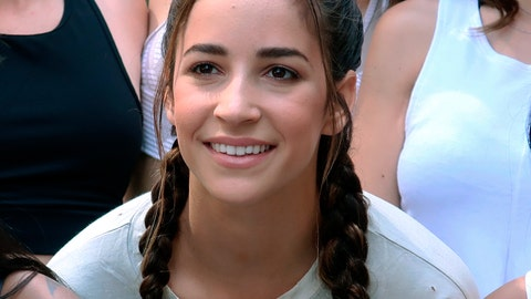 <p>               FILE - In this June 21, 2018 file photo, Olympic gymnast Aly Raisman poses with other yoga enthusiasts on International Yoga Day in Times Square in New York. Raisman said in a tweet on Wednesday night, Jan. 9, 2019, that she suffered a broken elbow in a fall on the stairs. (AP Photo/Ted Shaffrey, File)             </p>
