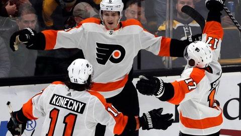 <p>               Philadelphia Flyers defenseman Travis Sanheim (6) celebrates his winning goal with teammates Travis Konecny (11) and Wayne Simmonds (17) in the overtime period of an NHL hockey game against the Boston Bruins, Thursday, Jan. 31, 2019, in Boston. (AP Photo/Elise Amendola)             </p>