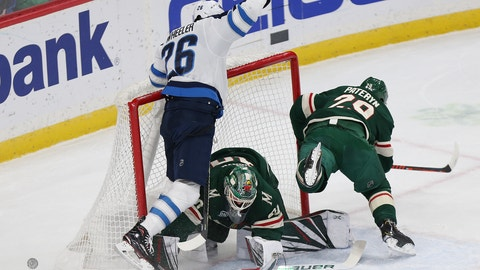 <p>               Winnipeg Jets' Blake Wheeler crashes into Minnesota Wild's goalie Devan Dubnyk after trying to score a goal in the first period of an NHL hockey game Thursday, Jan. 10, 2019, in St. Paul, Minn. (AP Photo/Stacy Bengs)             </p>