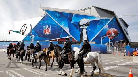 <p>               Police on horseback patrol past Mercedes-Benz Stadium ahead of Sunday's NFL Super Bowl 53 football game between the Los Angeles Rams and New England Patriots in Atlanta, Wednesday, Jan. 30, 2019. (AP Photo/David Goldman)             </p>